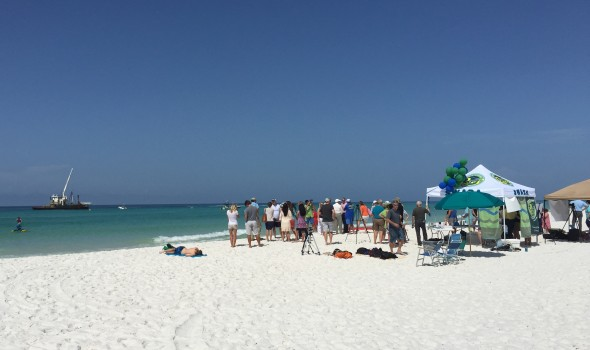 Tourists Watch as Barge Begins Installing Artificial Reef in Grayton Beach on July 10, 2015. Photo Credit: Linda Voorhees